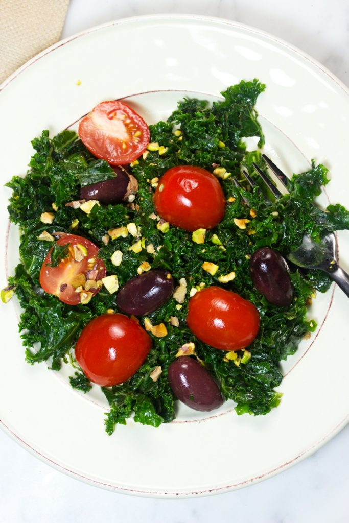 Super Delicious Massaged Kale Salad With Pistachios, Tomatoes, And Olives